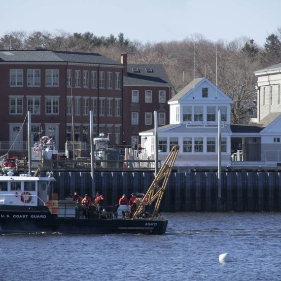 Coastguard vessel passes the harbormaster building